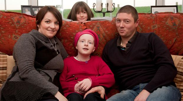 Chloe McCall with parents Lisa and Keith and sister Julia