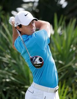 Rory McIlroy, of Northern Ireland, tees off on the second hole during the final round of the Honda Classic golf tournament