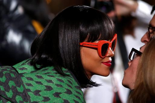 Singer Rihanna arrives at designer Stella McCartney as part of her Fall/Winter 2014-2015 women's ready-to-wear collection show during Paris Fashion Week