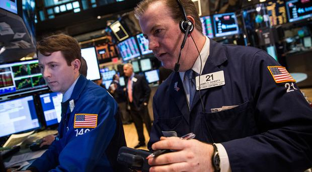 Traders on the New York Stock Exchange yesterday as turmoil in Ukraine affected global markets
