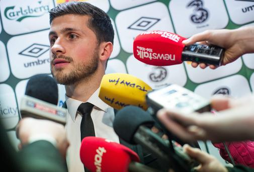 Shane Long speaks to journalists during the mixed zone