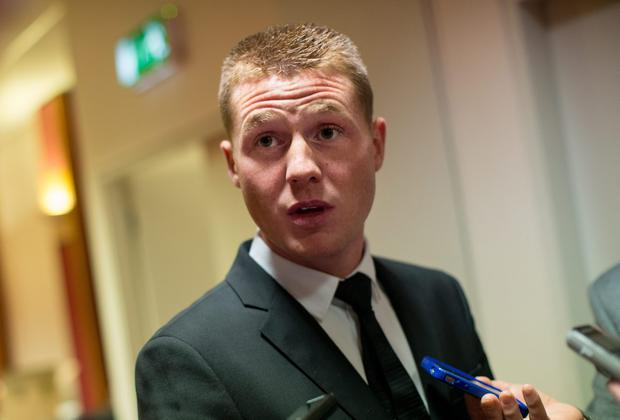 James McCarthy speaks with journalists during the mixed zone