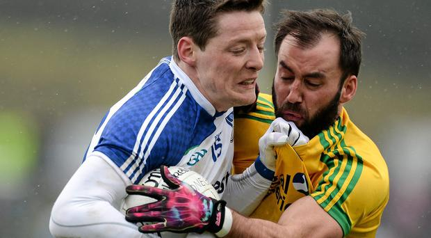 Monaghan's Conor McManus battles with Karl Lacey of Donegal during their NFL Division 2 clash in Letterkenny