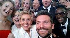 Oscar selfie shows movie stars, front row, Jennifer Lawrence, Meryl Streep, Ellen DeGeneres, Bradley Cooper and Nyong'o's brother Peter, and back row, Tatum Channing, Julia Roberts, Kevin Spacey, Brad Pitt, Lupita Nyong'o and Angelina Jolie.