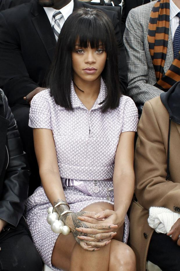 Singer Rihanna poses as she attends Chanel's ready to wear fall/winter 2014-2015 fashion collection presented in Paris, Tuesday, March 4, 2014. (AP Photo/Thibault Camus)