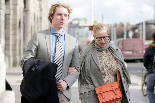 Neville with his mother Michelle leaving the High Court where he is taking a legal action against St Michael's College and St Vincent's Hospital