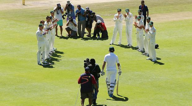 Graeme Smith of South Africa comes out to bat as the Australian team welcomes him with a guard of honour