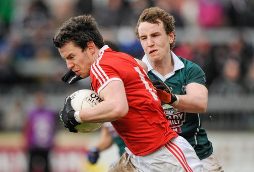 Mattie Donnelly, Tyrone, in action against Sean Hurley, Kildare