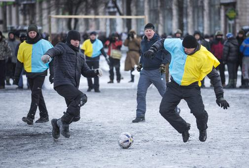 Anti-government protestors play football in Europe square in Kiev, Ukraine
