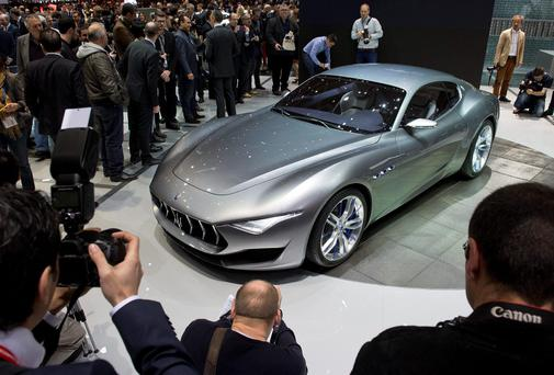 Flashy cars of Italian government ministers, many of whom drive cars like this luxury Maserati, are set to be auctioned on eBay