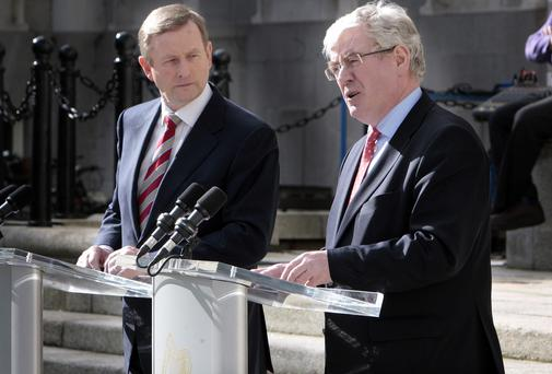 Taoiseach Enda Kenny and Tanaiste Eamon Gilmore at the launch of the report in Dublin yesterday. Picture: Tom Burke