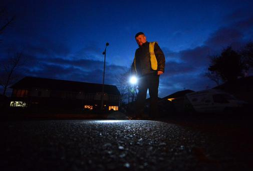 Pat McGarry, has to wear hi viz jackets and use a torch at night in Chambers Park, Kilock, Co Kildare where the street lights have been turned off. Photo: Adrian Melia