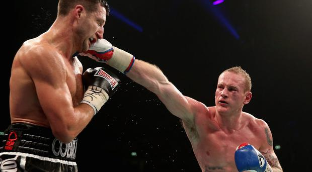 Carl Froch connects with George Groves during their IBF and WBA World Super Middleweight last November