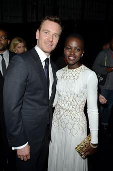 "Michael Fassbender and Lupita Nyong'o (R) arrive at the ""12 Years A Slave"" premiere during the 2013 Toronto International Film Festival"