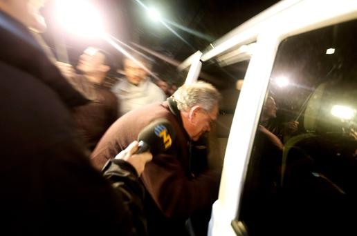 UN special envoy Robert Serry gets in a car in Simferopol March 5, 2014. Serry was forced to abandon a mission to Ukraine's Russian-occupied Crimea region on Wednesday after being stopped by armed men and besieged inside a cafe by a hostile crowd shouting