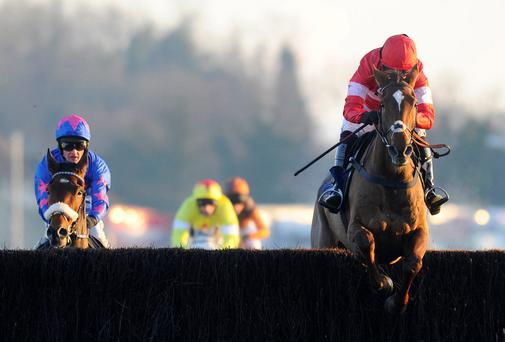 Noel Fehily riding Silviniaco Conti (R) clears the last to win The William Hill King George VI Steeple Chase from Cue Card