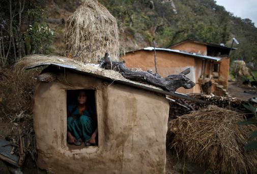 Uttara Saud, 14, sits inside a Chaupadi shed in the hills of Legudsen village in Achham District in western Nepal. Chaupadi is a tradition observed in parts of Nepal, which cuts women off from the rest of society when they are menstruating. Women who practice traditional chaupadi have to sleep in sheds or outbuildings while they are on their period, often with little protection from the elements. Reuters