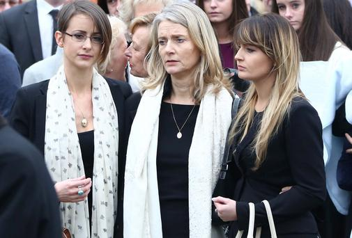 The widow of Gerry Collins Delly, with daughters Lisa, left and Ciara after funeral Mass at The Holy Rosary Church, Greystones Co. Wicklow this afternoon.