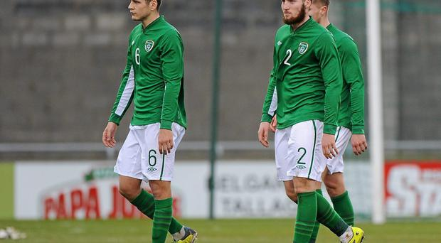 Ireland players Connor Smith, Matt Doherty and Jeff Hendrick leave the field after defeat to Montenegro in their UEFA Under 21 Championship Qualifier in Tallaght