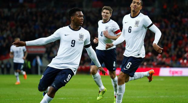 England's Daniel Sturridge celebrates his goal with Steven Gerrard and Chris Smalling during their international friendly soccer match against Denmark.