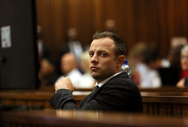 Olympic and Paralympic track star Oscar Pistorius sits in the dock on the third day of his trial for the murder of his girlfriend Reeva Steenkamp