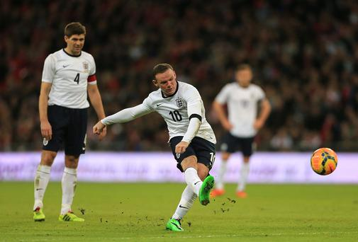 England's Wayne Rooney has a free kick attempt on goal