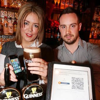 Emma Jane Hade pulls the perfect pint and checks out Bit Coin payment with Chris Healy, Marketing and Entertaining Manager, at The Bagott Inn.