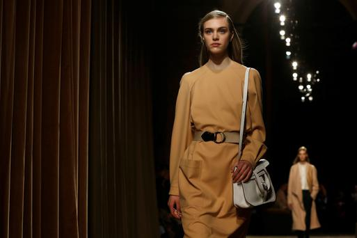 A model presents a creation by French designer Christophe Lemaire as part of his Fall/Winter 2014-2015 women's ready-to-wear collection for fashion house Hermes during Paris Fashion Week March 5, 2014. REUTERS/Gonzalo Fuentes (FRANCE - Tags: FASHION)