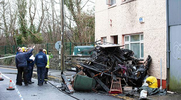 Investigators at the scene of the fatal house fire in Gort, Co Galway