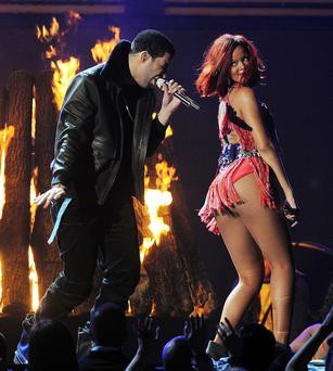 Singer Rihanna performs with Drake