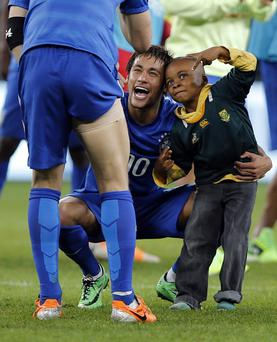 A South African boy who invaded the pitch jokes with Brazil's forward Neymar at the end of a friendly football match between South Africa and Brazil.