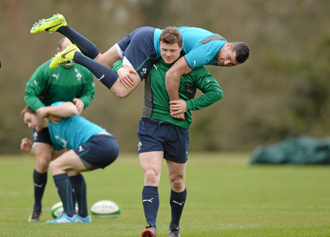 Ireland's Brian O'Driscoll carries Rob Kearney during squad training ahead of their side's Six Nations match against Italy.