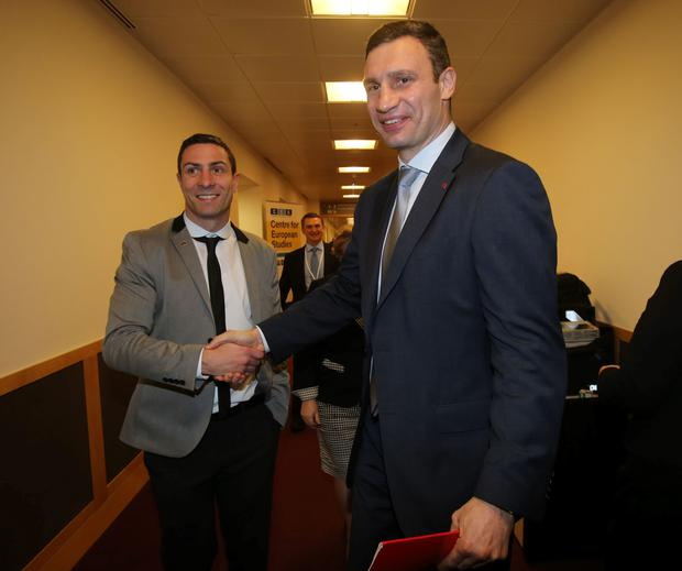 Ukrainian politician Vitali Klitschko meets Olympic Light-Heavyweight boxing silver medallist and Fine Gael candidate Kenneth Egan (left) at a meeting of the European People's Party Congress at the Convention Centre in Dublin