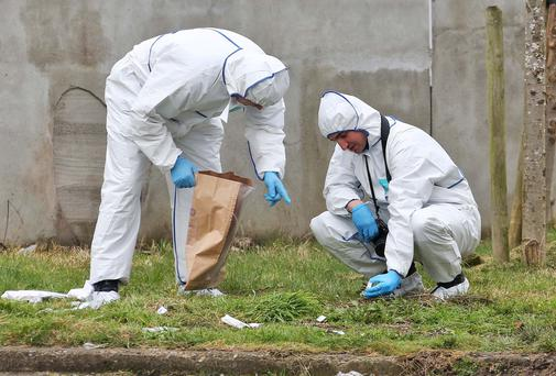 Forensic investigators at the scene in Finglas where Nicholas Duffy was shot in the knees. Picture: Colin Keegan, Collins Dublin.