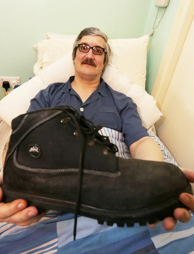 Shaun Aisbett pictured with one of his size 22 boots at his Greystones home yesterday. SEE FIONA DILLON COPY