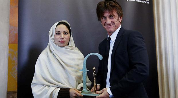 Actor Sean Penn presented the Front Line Defenders Awards 2014 to Ms Noorzia Afridi of SAWERA at an awards ceremony inAC Dublin City hall this morning. Photo: Mark Condren