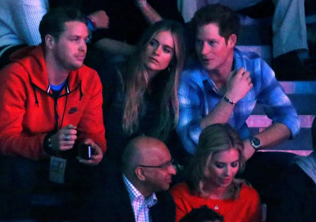 Britain's Prince Harry (R) and Cressida Bonas (2nd R) watch the WE Day UK event at Wembley Arena in London March 7, 2014. The inaugural WE Day UK event is run by the charity Free the Children to inspire young people to take action on global issues in a voluntary capacity. REUTERS/Luke MacGregor (BRITAIN - Tags: ENTERTAINMENT BUSINESS POLITICS EDUCATION SOCIETY ROYALS)