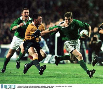 Brian O'Driscoll, Ireland is tackled by Daniel Herbert, Australia, Australia v Ireland, Subiaco Oval, Perth in 1999 in one of his first caps