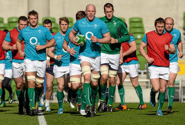 Paul O'Connell leads the Irish team in the warm up before the captain's run at the Aviva Stadium yesterday