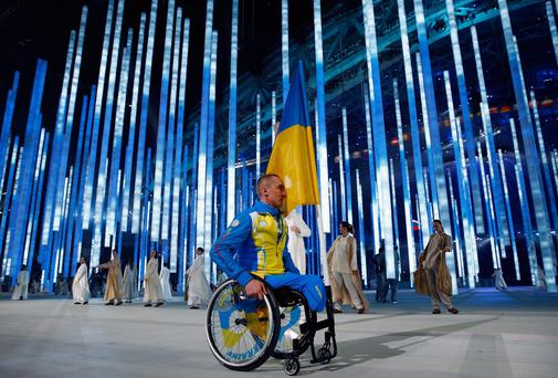 Flag bearer Mykailo Tkachenko of the Ukraine during the Opening Ceremony of the Sochi 2014 Paralympic Winter Games