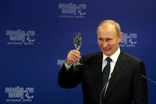 Vladimir Putin performs a toast prior to the Opening Ceremony of the Sochi 2014 Paralympic Winter Games. Getty Images