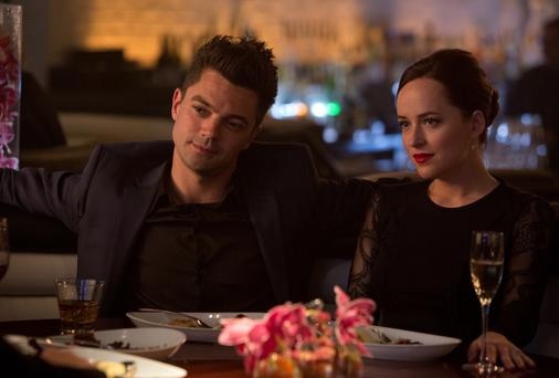 WHITE-KNUCKLE PLOT: Dominic Cooper and Dakota Johnson in a scene from Need for Speed.