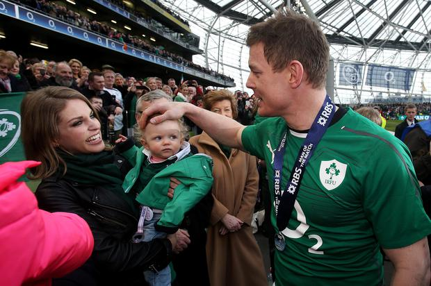 Ireland's Brian O'Driscoll with wife Amy Huberman and daughter Sadie after his final home international at the RBS Six Nations match at the Aviva Stadium