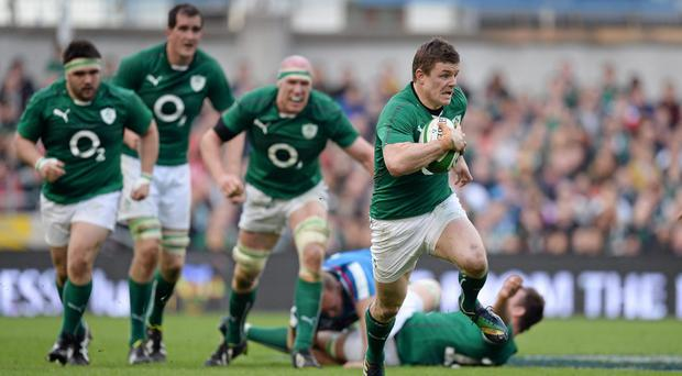 Brian O'Driscoll makes a break in his Ireland days