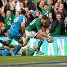 Jonathan Sexton touches down for his side's fourth try against Italy