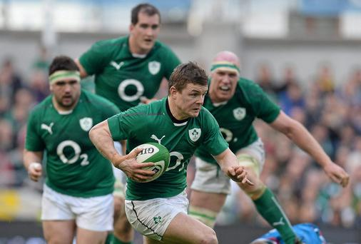Brian O'Driscoll breaks through the Italian defence as teammates Martin Moore, Devin Toner and Paul O'Connell look on