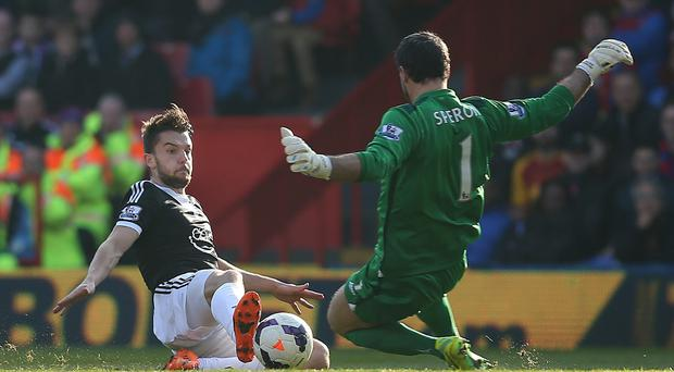 Jay Rodriguez of Southampton beats Palace keeper Julian Speroni to the ball to score the first goal of the game