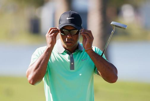 Tiger Woods walks to the 18th green during the third round of the World Golf Championships-Cadillac Championship