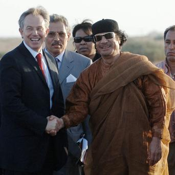 File photo dated 29/05/07 of Former British Prime Minister Tony Blair and Colonel Muammar Gaddafi shaking hands