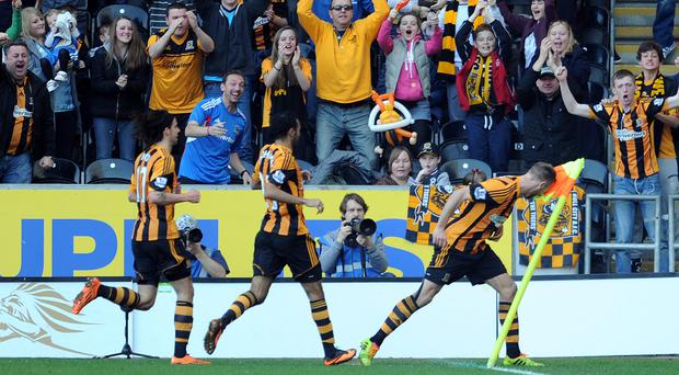 David Meyler (R) of Hull City celebrates after he scores the second goal of the game